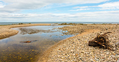 Where Cullen Burn Meets The Sea (williamrandle) Tags: cullenburn cullen morayfirth banffshire scotland northeastscotland uk 2017 summer beach cobbles pebbles burn stream river water reflections sky clouds outdoors landscape seascape beauty nikon d7100 sigma1835f18art rocks