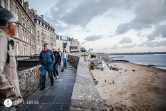 People walking on the walls of the city. Saint-Malo is a walled port city in Brittany in northwestern France (doctor.calavera) Tags: ancient breton water city tourist sea walled st island architecture wall fort view france building medieval old people brick harbor brittany pier town malo saint exterior bretagne tide stone castle travel fortified tourism french visiting sky outdoors europe saintmalo walk
