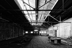 the missing executive (fallsroad) Tags: tulsaoklahoma industrial abandoned decay bw blackandwhite building architecture westernsupplycompany monochrome desk chair light windows beams steel nikonsigma