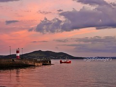Leaving Port, Donegal. (willieguildea) Tags: boat fishingboat port harbour quay water waterscape sunset evening twilight sky clouds lighthouse buncrana donegal inishowen ireland eire nikon coast coastal coastalireland seascape shore shoreline bythesea swilly loughswilly sea landscape