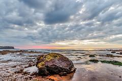 Rocky Cloudy Sunrise Seascape (Merrillie) Tags: daybreak sand landscape nature water newsouthwales rocks nsw beach scenery clouds newport earlymornings waterscape sea australia dawn seascape