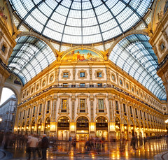 The Galleria Vittorio Emanuele II In Milan (Stuck in Customs) Tags: milan stuckincustomscom treyratcliff stuck in customs building volkswagen vw car robot machine view 2017 buildings purple golden yellow black lighting lights glow glowing light inside indoor indoors europe rr photo daily pattern architecture color colour symmetry glass reflection red orange green white blue horizontal trey ratcliff treyratcliffcom 80stays hasselblad x1d
