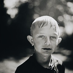Little D (7thound) Tags: eyes michigan people blackandwhite mediumformat bokeh squareformat pentacon6 kodakektar kodak scanned analog film water wet blond child summer preteen boy portrait