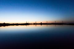 Splitted Skyline (Nikonierer) Tags: denmark copenhagen goldenhour reflection smooth amagerstrand sea beach night light sunset outdoors nature landscape water sky dawn industry
