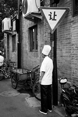 Chef (Go-tea 郭天) Tags: pékin beijingshi chine cn hutong gulou beijing old traditional tradition ancient history historical historic buildings houses construction chef cook restaurant uniform hat busy duty business job break work working observation observing label stand alone lonely bikes bicycles triangle arrow aircon bricks candid back backside street urban city outside outdoor people bw bnw black white blackwhite blackandwhite monochrome naturallight natural light asia asian china chinese canon eos 100d 24mm prime man