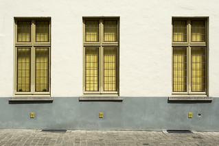 Three yellow windows