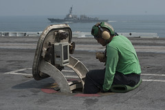 Sailor operates a sound-powered telephone on the flight deck of USS Harry S. Truman. (Official U.S. Navy Imagery) Tags: atlanticocean abw