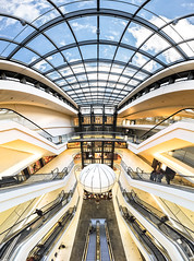 Summer in Berlin (PK Visuals) Tags: ballon berlin boulevard deutschland escalator germany girls mall moving pk public shoppingcenter spider staircase vertorama window atrium people sky yellow