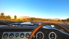 The Sights (Mr. Pebb) Tags: jaguar etype british frontengined classiccar classic sportscar rearwheeldrive rwd interior gauges fh3 forza horizon3 photomode videogame turn10 t10 microsoft xboxone stockshot steeringwheel hills hillside scenery blueskies bluesky countryside