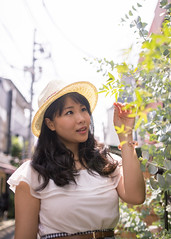 Young woman looking at green leaves on street (Apricot Cafe) Tags: img660849 asia asianandindianethnicities harajuku healthylifestyle japan japaneseethnicity sigma35mmf14dghsmart tokyojapan beautifulwoman buildingexterior carefree charming cheerful colorimage day elegance enjoyment happiness lifestyles longhair lookingup nature oneperson onlyjapanese onlywomen onlyyoungwomen outdoors people photography smiling street summer sunlight threequarterlength vertical women youngadult