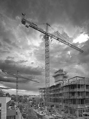 Had a storm come through when our photographing cranes. (uptownguydenver) Tags: denver colorado architecture architectural structures building edifice edifices commercialbuilding skyscraper residentialbuilding misccityview phaseone captureone xf iq3100 100mpclub cranes craneproject morning construction constructionequipment business capitalism commerce enterprise mercantilism trade industry cherrycreek usa