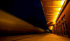 At The Train Station (daynawines) Tags: longexposure nightphotography light building movement night outdoor outside