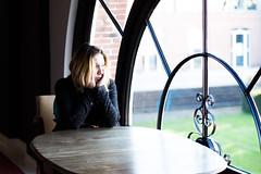 Johanna (Premouilong) Tags: fenêtre lumière profondeur de champs table visage portrait femme bois fer clair obscur window light deep field woman wood iron chiaroscuro
