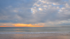 Cloudy Sunrise Seascape (Merrillie) Tags: daybreak sand landscape nature water newsouthwales rocks nsw beach scenery clouds newport earlymornings waterscape sea australia dawn seascape