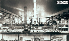 GN373 (Lane County Historical Museum) Tags: eugeneoregon lanecountyhistoricalmuseum vintage historicalphoto oregonhistory digitalcollection commercialinterior shopkeepers downtownbusiness