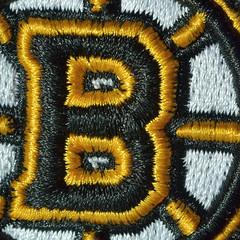 Theme sewn up! (robjvale) Tags: nikon d3200 memberschoicetexture macromonday macromondays hmm texture thread blackandgold bruins logo