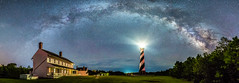 Below the milky way at Cape Hatteras Light House (Robert Loe) Tags: capehatteraslighthouse capehatteras lighthouse milkyway stars starscape landscape green grass glow light explore inexplore explored night photography pano panorama panoramic wideview dramatic dynamic blue clear clearsky trees famousplace stripes northcarolina outerbanks obx
