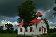 Farmers Creek School (SCOTTS WORLD) Tags: adventure architecture america angle americana sky shadow summer school rural rainy stormy red windows white trees building bluesky storm michigan midwest baldwin fun farmerscreek light leaves lapeer panasonic pov perspective july 2017 historic oneroomschoolhouse exploring education green grass windy