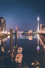 Düsseldorf Nights (mattinho2704) Tags: night deutschland nikon water germany city cityscape düsseldorf reflexion neutraldensityfilter blue urban photographycity neutraldensity boats longexposure nrw architecture clouds colours polarizer haida reflection