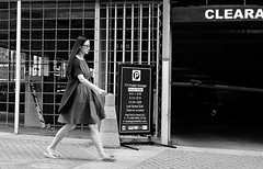 Bows On Her Toes (burnt dirt) Tags: houston texas downtown city street sidewalk crosswalk girl woman people person group crowd asian latina blonde brunette sexy cute longhair shorthair ponytail heels stilettos boots dress jeans shorts skirt stockings friend athlete sunglasses glasses office building worker streetphotography portrait fujifilm xt1 bw tattoo young model