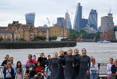Good backdrop for a performance (_steve h_) Tags: streetphotography london urban candid sony nex6 gdif 2017 greenwich docklands international festival mulïer contemporary dance ladies stilts backdrop background river city