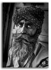 Face of Age! (FotographyKS!) Tags: editorial portrait mustache drama emotion elder elderly face male old aged people senior thinking thoughtful jaisalmer goldenfort sonarquila rajasthan outdoor life india indian asia wrinkle wrinkled happy tradition traditional adult clothing colorimage humanhair photography pride turban culture ruralscene rajput spirituality indianethnicity beard longbeard manwithbeard forehead hinduism lookingatcamera indianmen senioradult ethnic grayhair whitehair character oneperson village agingprocess outdoors sitting lifestyle closeup traditionalclothing vertical eyes facialhair facialexpression day