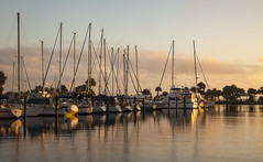 Morning light (in Explore) (mimsjodi) Tags: sunrise indianriverlagoon titusvillefl marina boats water reflections