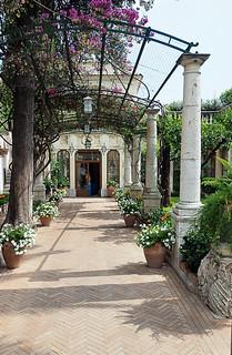Entrance to restaurant with garden in Taormina, Sicily, Italy
