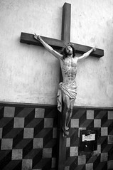 Spanish mission: crucifix (Star Tornero Photo - in Spain) Tags: bw mission church historic spanish catholic building detail wall sanxavierdelbac tucson az arizona tohonooodhamsanxavierindianreservation jesus christ statue crucifix dsc0476