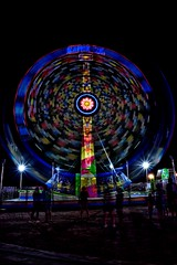 Kamikaze! (slammerking) Tags: countyfair carnival fair amusementride kamikaze spinning longexposure night dark slowshutterspeed motion timeexposure