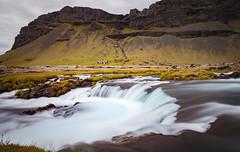 Flowing (Jack Landau) Tags: waterfall water fall iceland glacial blue river stream long exposure shutter drag landscape nature rocks mountains clouds jack landau