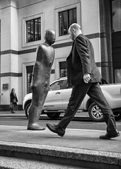 striding man (keith ellwood) Tags: street london city commuters tonal black white reflections