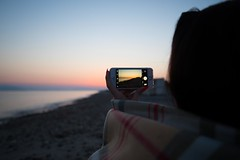 Caught photographing (donnicky) Tags: greece kos mariiabobrovskaia beach blurredbackground camera clearsky closeup dawn device dof gadget girl hand headshot holding horizont iphone leisure nature oneperson onlywomen outdoor phone photographing publicsec rearview sea seaside sky summer travel vacation water