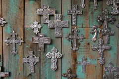 Crosses and Noughts (David K. Edwards) Tags: cross medallions milagros hanging wall wooden metal religious jacalope santafe newmexico