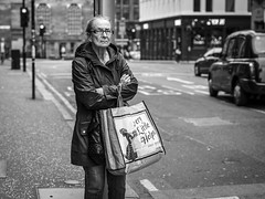 Very Little Helps (Leanne Boulton) Tags: urban street candid portrait portraiture streetphotography candidstreetphotography candidportrait streetportrait eyecontact candideyecontact streetlife old woman female face facial expression eyes look emotion feeling mood atmosphere bodylanguage folded arms tone texture detail depthoffield bokeh naturallight outdoor light shade shadow city scene human life living humanity society culture people canon canon5d 5dmkiii 70mm character ef2470mmf28liiusm black white blackwhite bw mono blackandwhite monochrome glasgow scotland uk