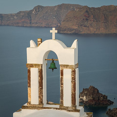 Santorini's Bell (catchapman44) Tags: building church churchbell churchcross roof equipment canon5dmarkiii canon type photography landscape architecture scenic summer sunrise surreal santorini bluesky cycladesislands europe greece greekislands travel whitebuildings mountain mountainridge sea