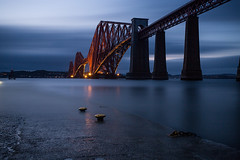 Made in Scotland..... (GlasgowPhotoMan) Tags: forth firthofforth forthbridge forthrailbridge networkrail queensferry southqueensferry water bridge railway train longexposure bigstopper night nightshot dusk bluehour cantileverbridge scotland iron unesco unescoworldheritagesite balfourbeatty