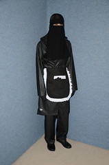 Slave Waitress (Warm Clothes Fetish) Tags: niqab hijab chador burka girl anorak coat rainwear sweat boots torture slave warm maid waitress apron