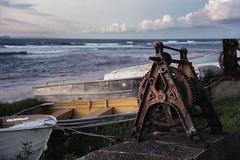 Fishermans Beach, 2012  #193 (lynnb's snaps) Tags: 2012 35mm longreef mjuii superia1600 beach boats colour film machinery v700 sydney olympusmjuii coast winch rusty old landscape ocean sunset fujifilmsuperia1600 grain