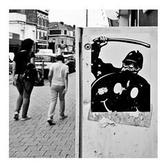children of the revolution (japanese forms) Tags: ©japaneseforms2017 ボケ ボケ味 モノクロ 日本フォーム 黒と白 appropriation bw blackwhite blackandwhite blancoynegro bokeh candid childrenoftherevolution guydebord mai1968 monochrome random schwarzweis smiley square squareformat sticker strasenfotografie straatfotografie streetphotography streetart trex vlaanderen zwartwit
