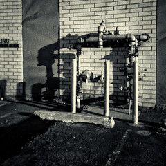 Protected Pipeline 3 (EssGee Photography™) Tags: aristacolor200 35mm analog brick building film industrial kv250 newyork ny shadow shadows vignette vignetting pipeline blackandwhite