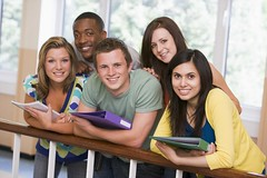 Group of college students leaning on banister (hugosales3) Tags: college campus students friends corridor university hall youngadult education higherlearning caucasian color colour image horizontal indoors fivepeople group man women pakistani africanamerican leaning standing smiling happy lookingatcamera railing banister student holding ringbinder folder notepad freshman freshmen 18yearold 20s twenties furthereducation highereducation portrait class