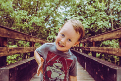 Cute Kid on a Bridge - His Go To Expression (Cole Eaton Photography) Tags: portrait son bridge forest nature walk kid baby smile goofy fun lighthearted ninja turtles portraits park allfreepicturesjuly2017challenge boy young vibrant kids sibling eyes 1person one persoin sedona national state leading lines teenage mutant leadinglines wood wooden face short what you doing trees vacation candid silly look looking facing dance photo natural frame leaf leaves green turtle dude blond blonde antique vintage family families lightroom dslr canon rafael care love kiddo mine playful