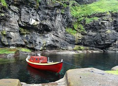Faroese fishing boat (Jaedde & Sis) Tags: føroyar eysteroy gjógv boat harbour red rocks cliffs challengefactorywinner thechallengefactory flickchallengewinner flickrchallengegroup