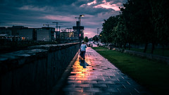 Walking the baby - Dublin, Ireland - Color street photography (Giuseppe Milo (www.pixael.com)) Tags: streetphotography mother urban color sunset ireland woman dublin city faceless grass countydublin ie onsale