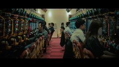 Japanese Arcade, Kyoto, Japan (emrecift) Tags: candid portrait street photography crowd japanese game center arcade kyoto japan cinematic 2391 anamorphic crop sony a7 alpha legacy lens glass canon new fd 35mm f28 emrecift