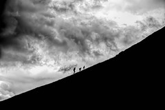 Race to the top (simon.mccabe.5) Tags: simonmccabe uk yorkshire cove malham children silhouettes cloud bw race father storm black white