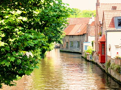 A beautiful canal in Bruges (Digidoc2) Tags: water buildings worldheritagesite trees sky blue architecture oldcity town cityscape houses warehouses banks canal urban