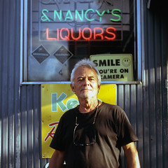 (patrickjoust) Tags: tlr twin lens reflex 120 6x6 medium format color film manual focus analog mechanical patrick joust patrickjoust baltimore maryland md usa us united states north america estados unidos urban street city chrome slide e6 reversal expired discontinued fuji corner store bar neon sign smile man portrait