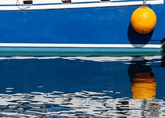 Reflections (Karen_Chappell) Tags: buoy boat blue white orange marine nfld newfoundland stjohns fishing reflections reflection abstract painted paint avalonpeninsula atlanticcanada atlantic canada harbour ripples water ocean